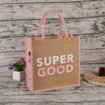 Bolsa de yute lateral y asas color rosa logo - RG regalos publicitarios